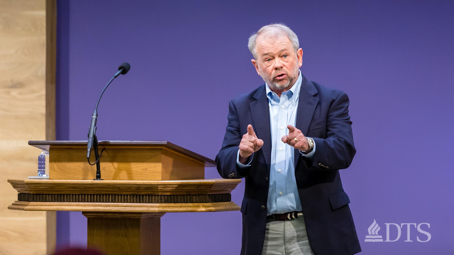 man standing near podium speaking at DTS Chapel
